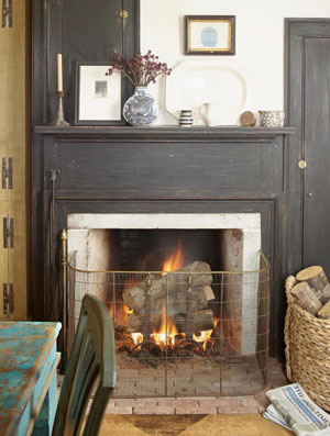 Country home fireplace with black mantel