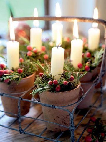 Xmas candles in terracottta pots