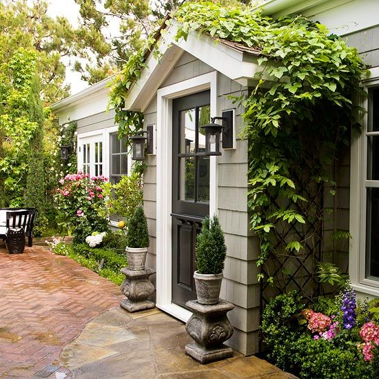 Light gray shingles with dutch door