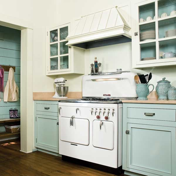 Vintage stove with green cabinets