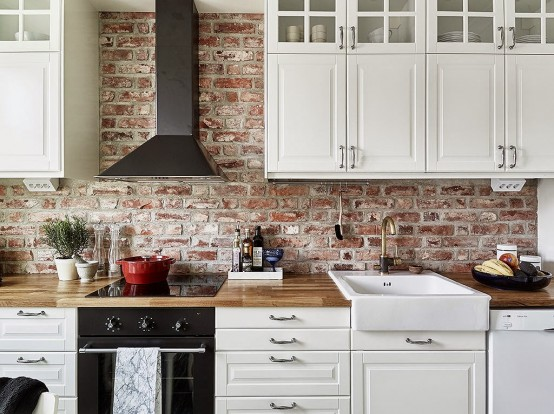 White kitchen with brick