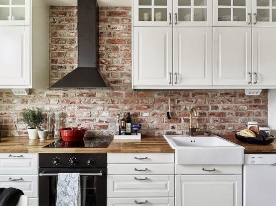 White kitchen with brick