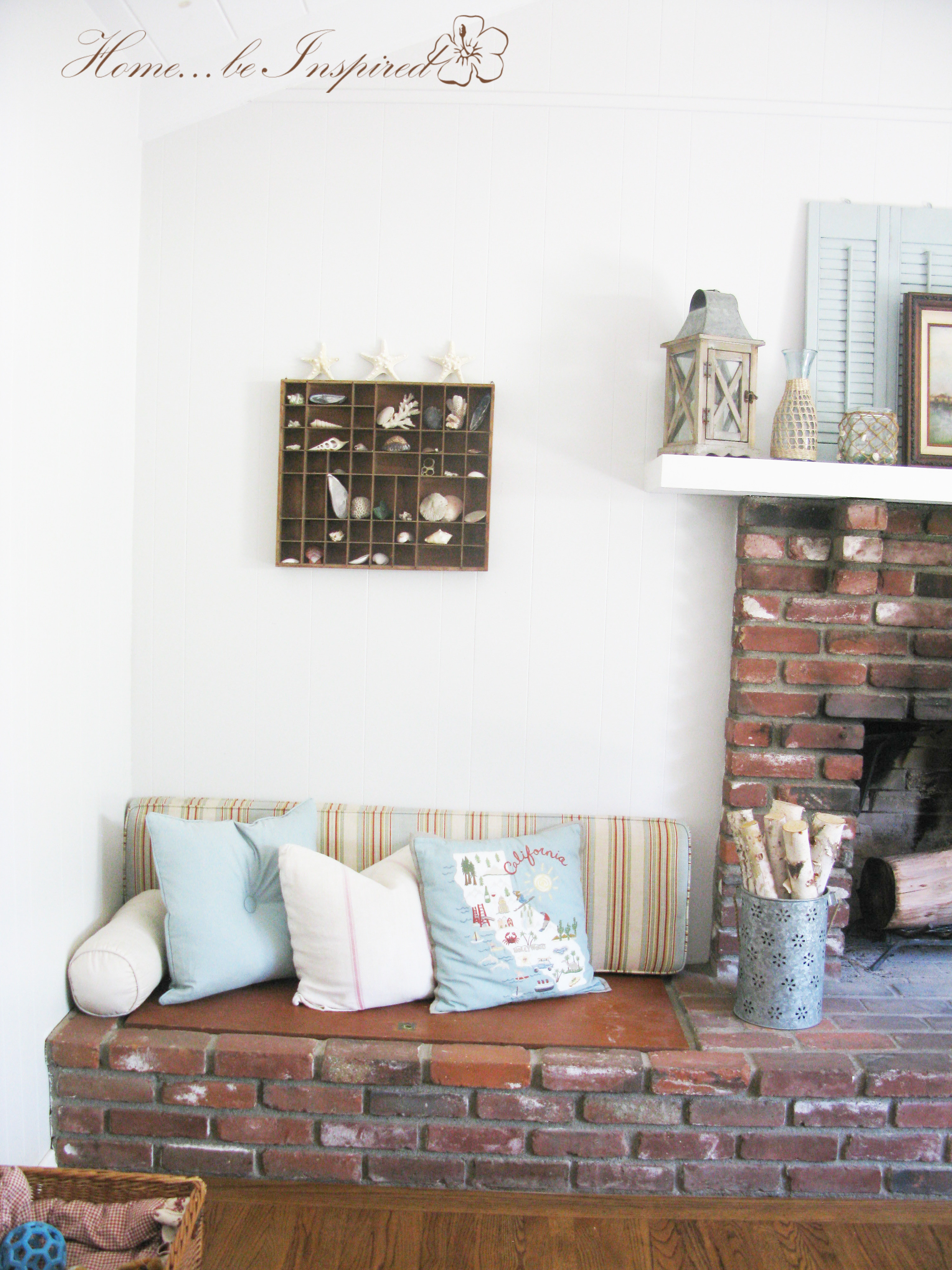 This is my favorite inspirational photo on little nooky sitting areas that surround a fireplace. I love the patterned red and white cushions