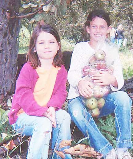 Madison and Kenz with apples