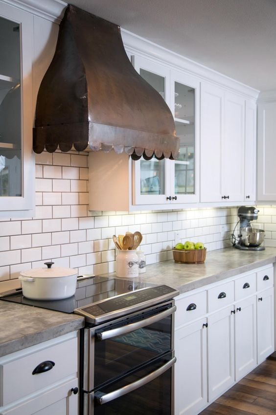 White kitchen with hood  fixer upper
